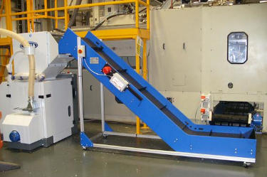 Conveyor with plate metal detector feeding granulator