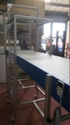 horizontal conveyor with shielded robot enclosure